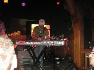 Jason Lytle checks his keyboard