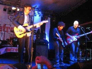 Josh Epstein on guitar, Fabian Halabou on guitar, Mike Majewski on bass